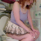 A girl with red hair sits down on a toilet, farts and takes a shit with audible, hard plops. She wipes her ass while standing. Audio is somewhat compressed. Presented in 720P HD. About 5.5 minutes.